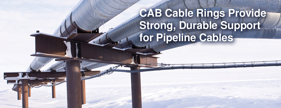 Wide photo of CAB Cable Rings and Saddles running under Alaska Oil Pipeline in harsh cold wet corrosive environment