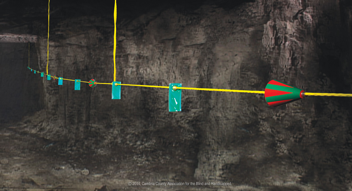 Photo of CAB Rope Lifeline with directional cones and markers in coal mIne