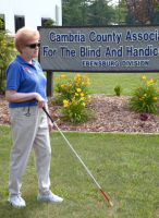 Here we see Bernie using a white cane. She received orientation and mobility training with the PA Bureau of Blindness and Visual Services, through a referral from CCABH.