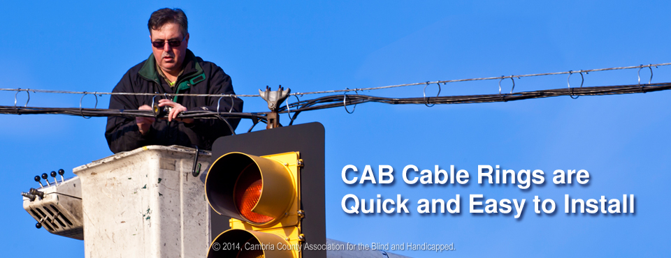 Photo of worker installing stoplight with CAB Cable Rings and Saddles