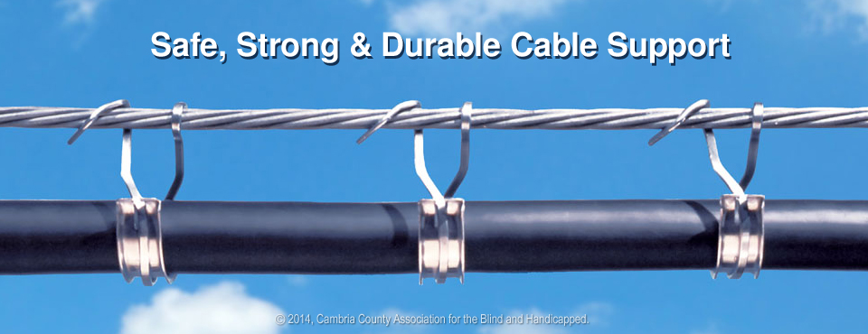 Photo of uncoated CAB Cable Rings and Saddles supporting large wire