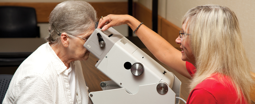 CCABH worker testing vision of older lady with Titmus Vision Screener