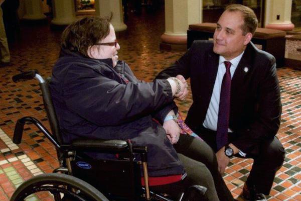 CAB employee shakes hands with PA State Senator Wayne Langerholc