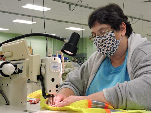 Kim, sewing machine operator